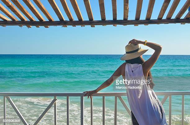 woman staring at the sea, cayo coco, cuba. - radicella stockfoto's en -beelden