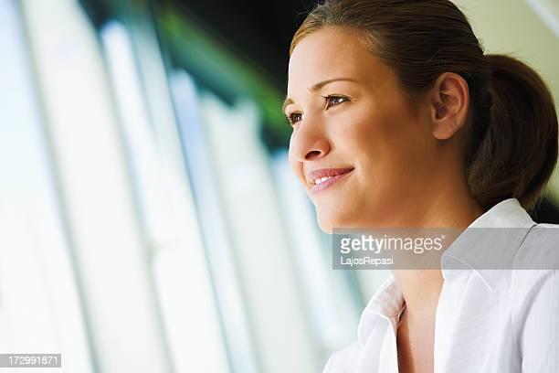 Woman staring outside open window blinds