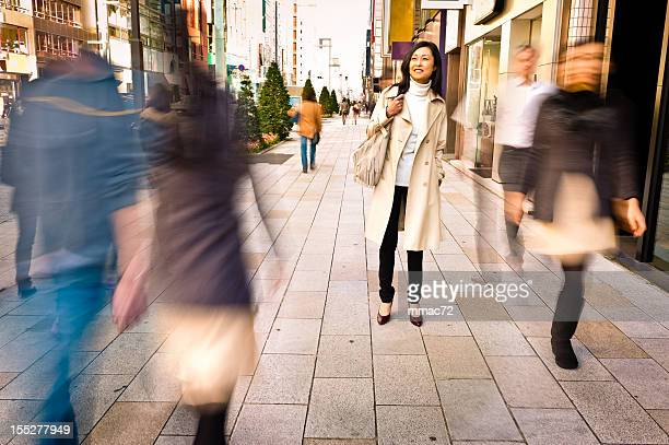 Woman Staying in a Crowded Street