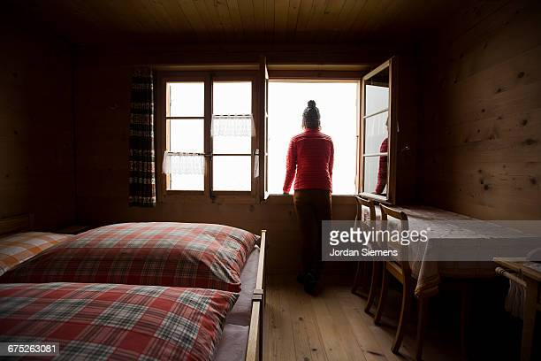 A woman staying in a Swiss Chalet