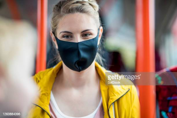 woman staying protected during covid 19 - public transport stock pictures, royalty-free photos & images