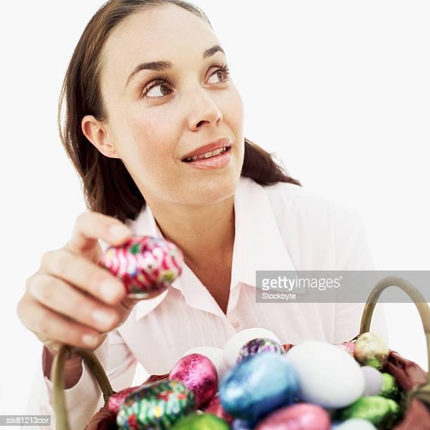 woman stealing an Easter egg