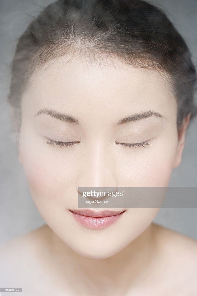 Woman steaming her face : Stock Photo