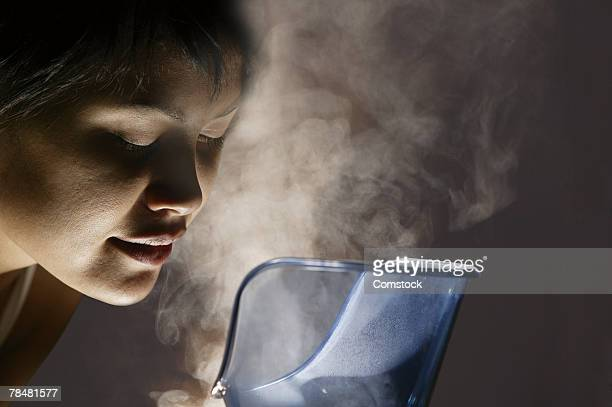 woman steaming her face - pores stock photos and pictures
