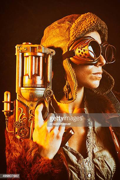 woman steampunk gunslinger - aviation hat stock photos and pictures