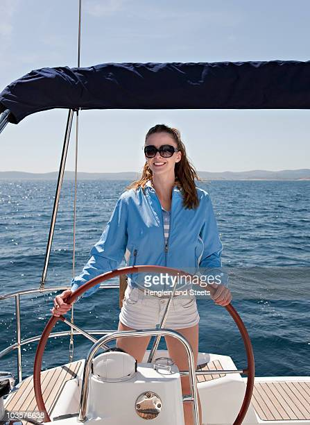 Woman steering yacht