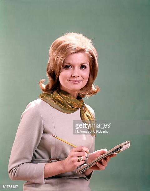 woman stenographer secretary with pencil and notepad for dictation. - sixties photos et images de collection