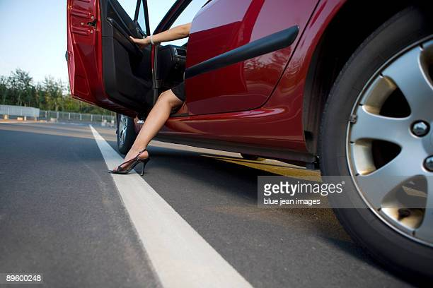 Woman stepping from drivers seat