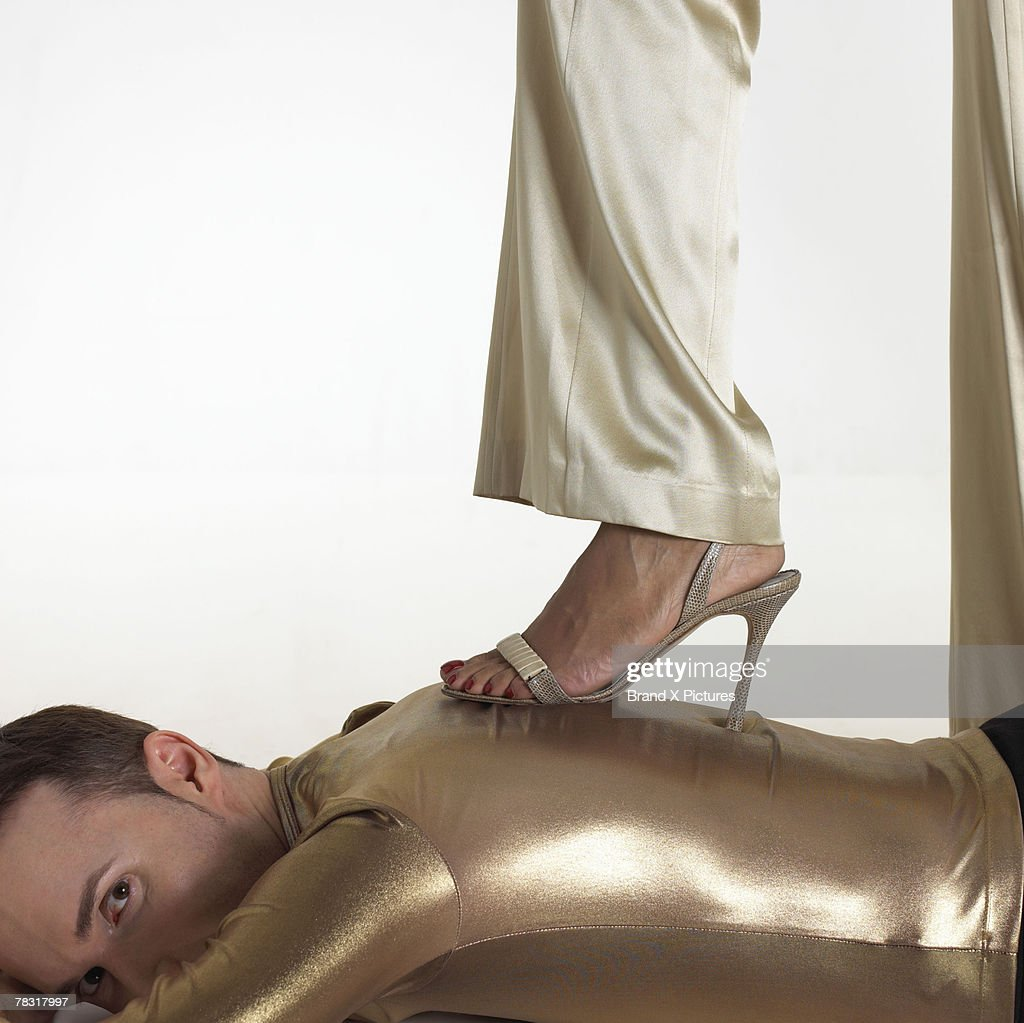 Woman Stepping On Man With Stiletto Heel High-Res Stock ...