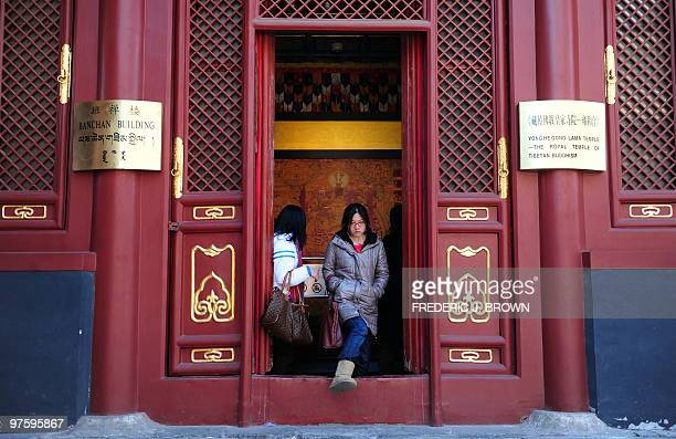 A woman steps out of the Panchen Building a hall built in 1780 as a temporary lounge for the Sixth Panchen Erdeni who visited Beijing to celebrate...