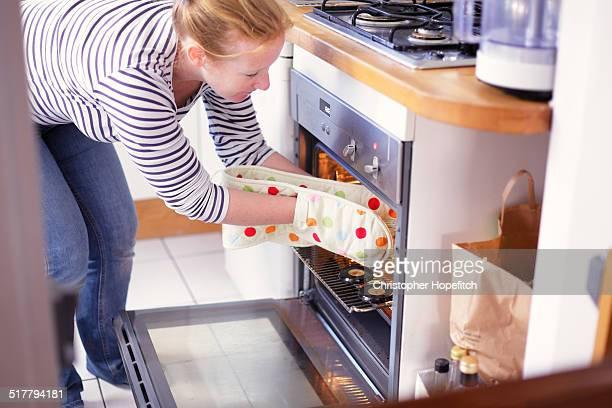 Woman sterilising jam jars