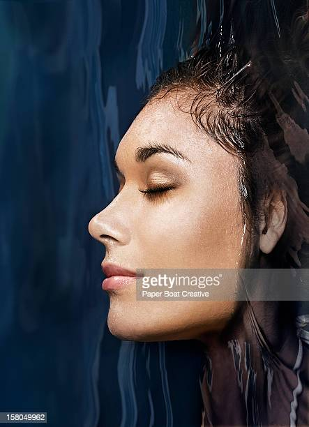 woman sticking her head out of the water - spa treatment stock pictures, royalty-free photos & images