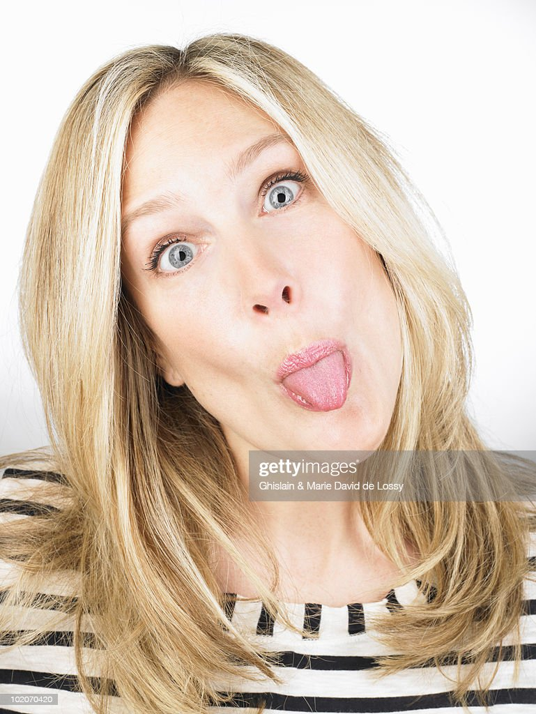 Woman sticking out her tongue : Stock Photo