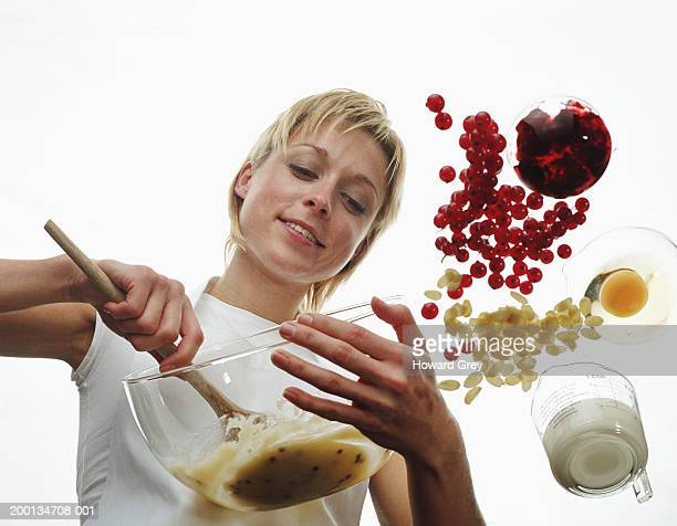 Woman stirring cake mixture, low angle view