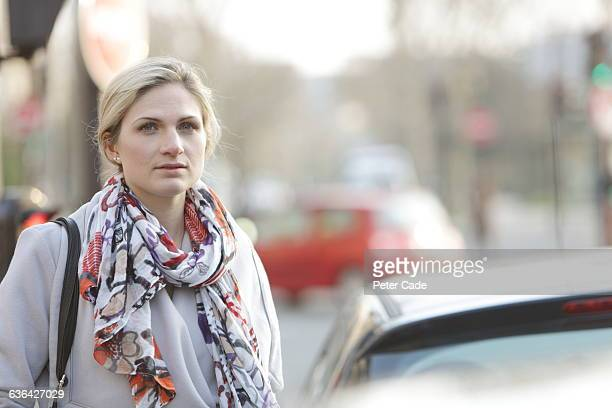 Woman stood by busy road