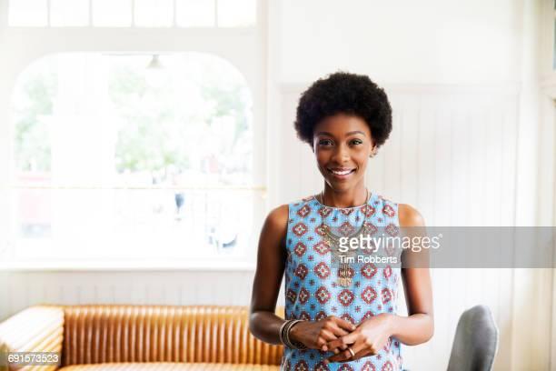 Woman stood looking at camera