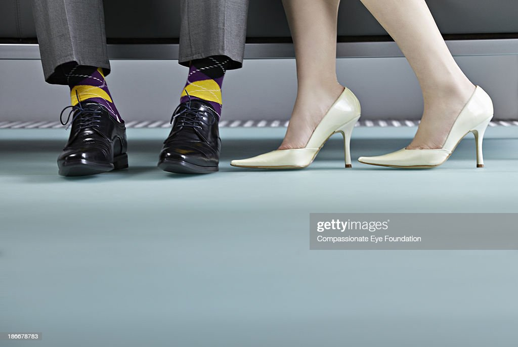 Woman stood next to man, view of shoes : Stock Photo