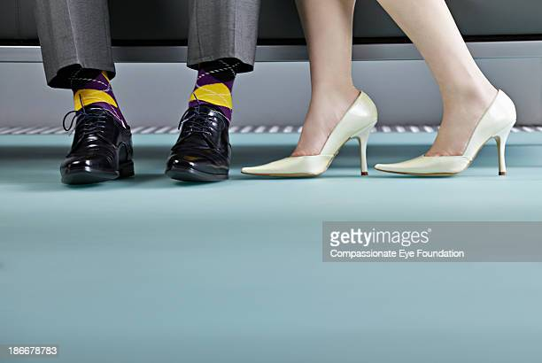 Woman stood next to man, view of shoes