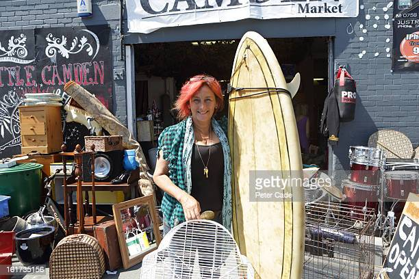 Woman stood outside junk shop