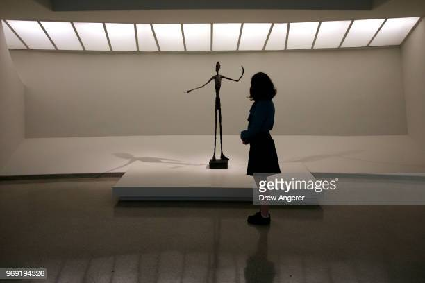 A woman stops and views 'Man Pointing' a 1947 bronze sculpture at a retrospective exhibition of work by Swiss sculptor and artist Alberto Giacometti...