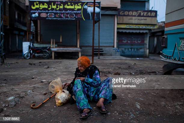 A woman stops to break her fast with dates at 'Iftar' when Muslims break their fast on the third day of the holy month of Ramadan on August 4 2011 in...