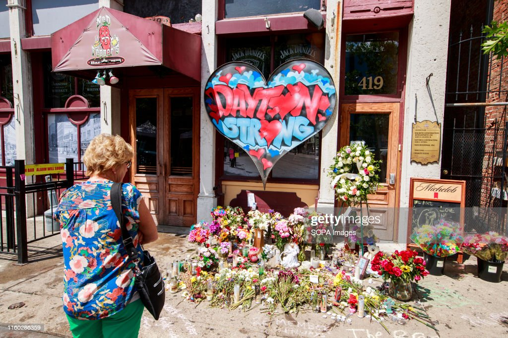 A woman stops to look at a memorial on 5th Street at the... : News Photo