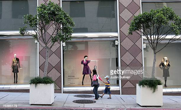 A woman stops to look at a window display at a Neiman Marcus department store July 12 2007 in San Francisco California With gas prices at record...