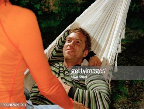 Woman Straddling Man In Hammock Closeup Stock Photo