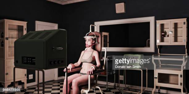 woman strapped into mind control chair for brainwashing - cult stock pictures, royalty-free photos & images