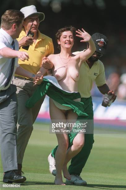 A woman streaker at Lords is escorted off the pitch