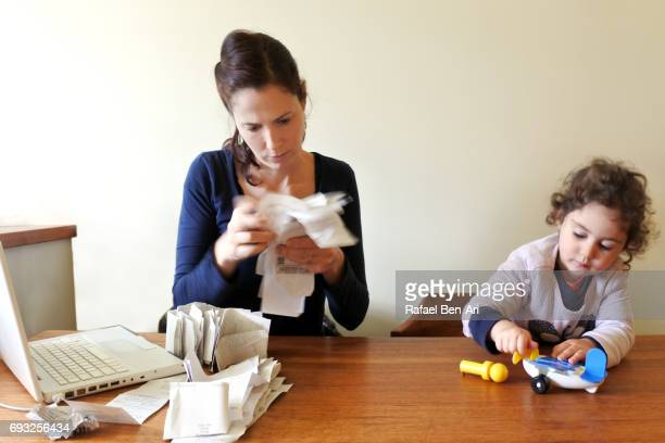 woman stressed over accounting  work - rafael ben ari stockfoto's en -beelden