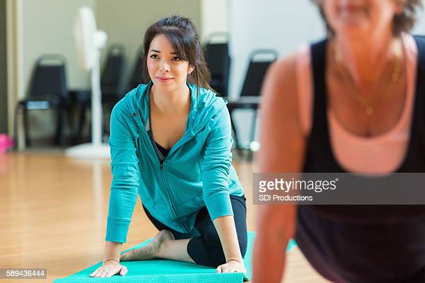 Woman stretches during exercise class