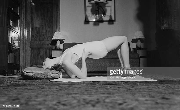 Woman stretches in her living room ca 1940