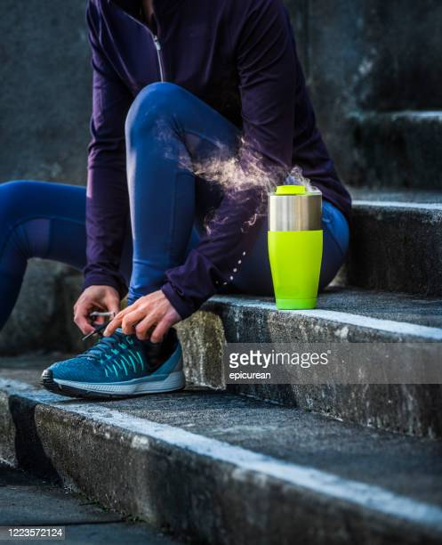 woman stretching and getting ready to go for a run - petaluma stock pictures, royalty-free photos & images