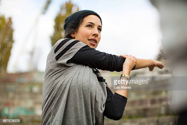 woman stretching arms before exercise - warm up exercise stock pictures, royalty-free photos & images