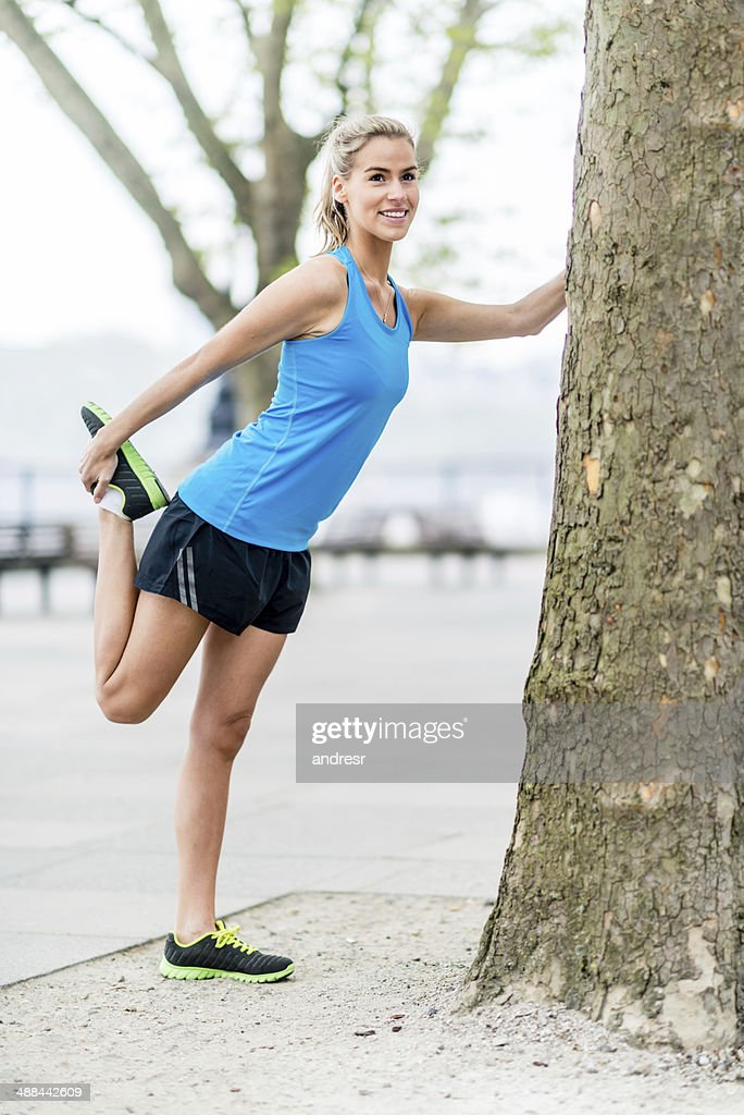 Woman stretching at the park : Stock Photo