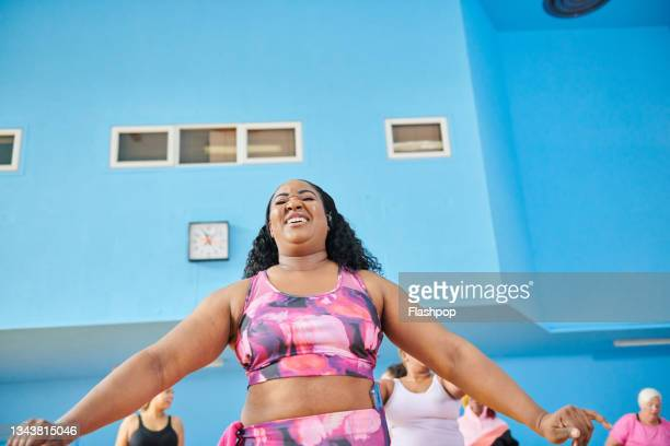 woman stretching her arms and torso. - human limb stock pictures, royalty-free photos & images