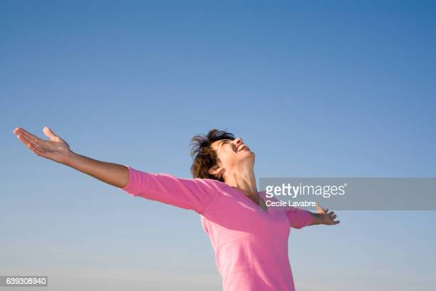 Woman stretching her arms in nature