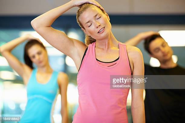 woman stretching her neck  at gym - neck stock pictures, royalty-free photos & images