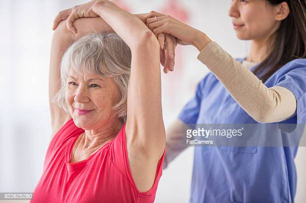Woman Stretching in Physical Therapy