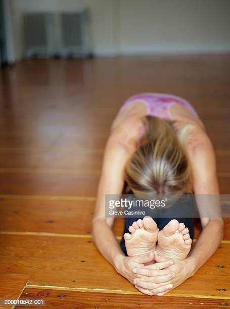 woman stretching in yoga studio - soles pose stock pictures, royalty-free photos & images