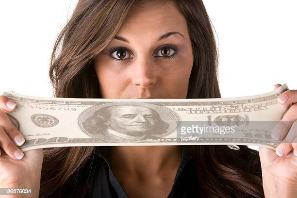 Woman stretching money over her mouth
