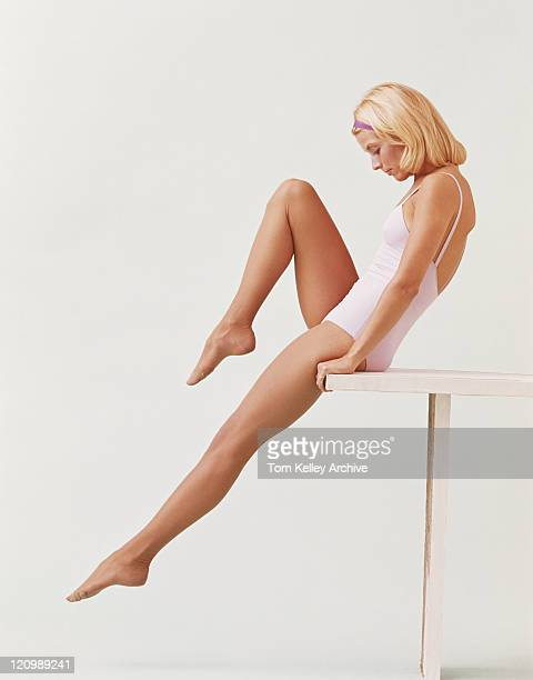 woman stretching on balance beam - leotard stock pictures, royalty-free photos & images