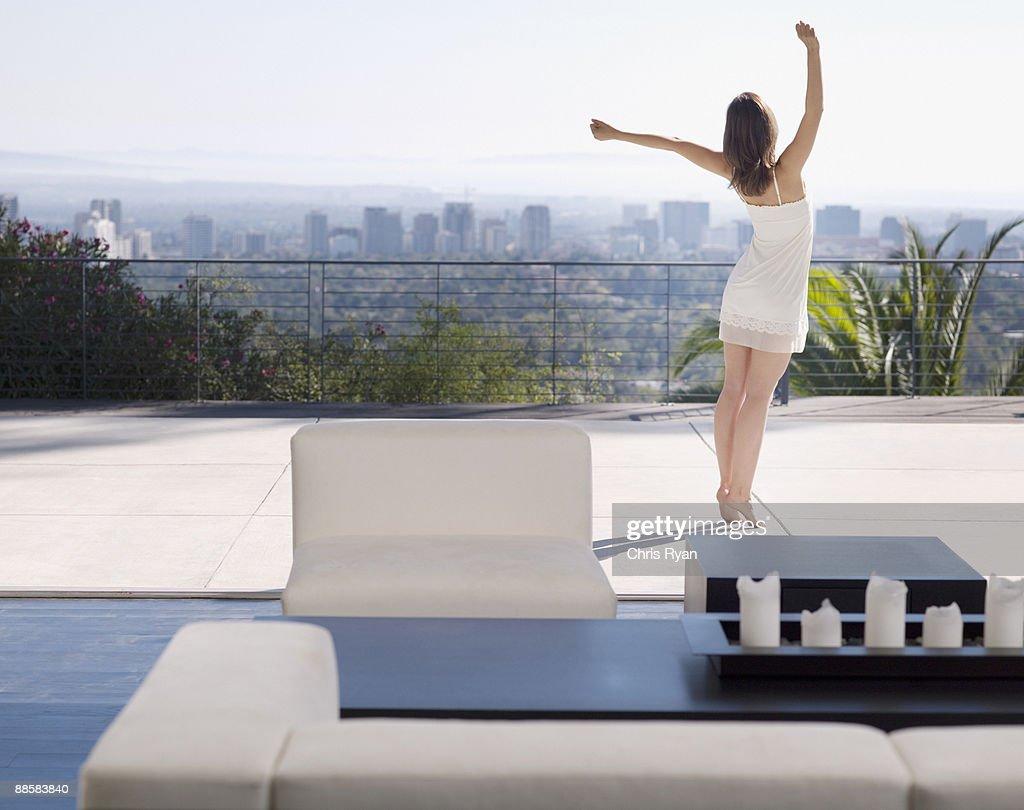 Woman stretching on balcony : Stock Photo
