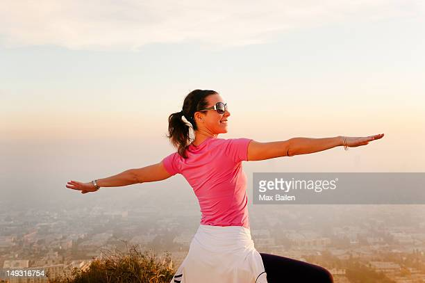 woman stretching on hilltop - smog stock pictures, royalty-free photos & images