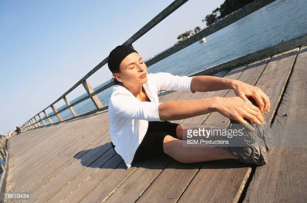 Woman stretching on pier