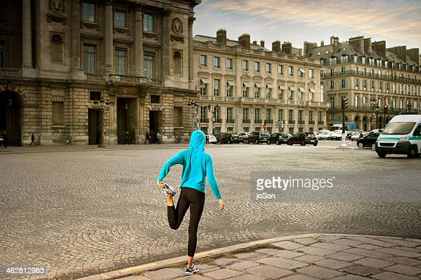 woman stretching on side walk