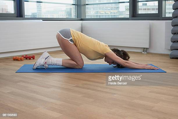 A woman stretching on the ground