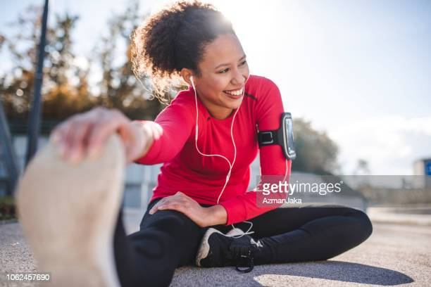 woman stretching - exercising stock pictures, royalty-free photos & images