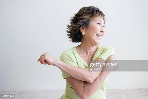 woman stretching - one mature woman only stock pictures, royalty-free photos & images